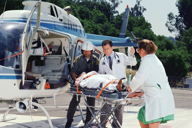 Medical Team Transporting Patient to Helicopter